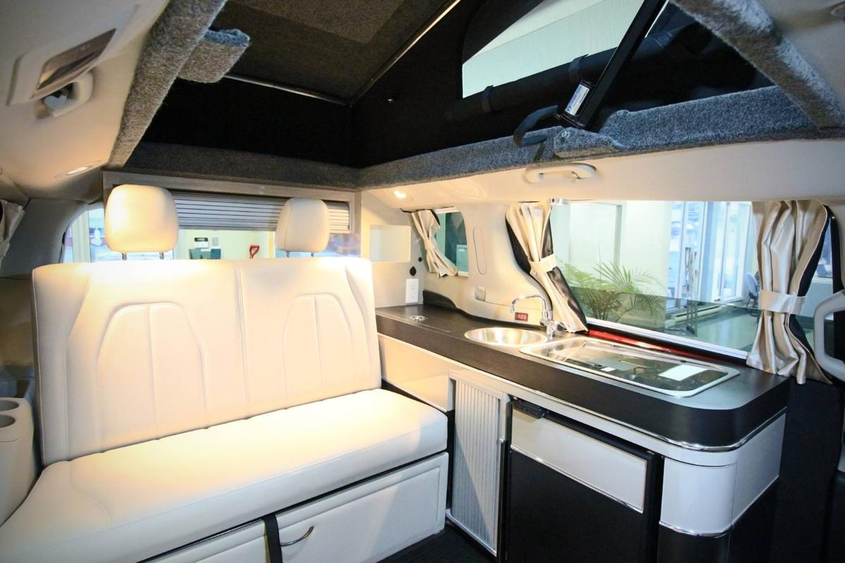 The 5 Mars Illusion Hybrid has a simple, two-sleeper interior with small kitchen block and convertible bench/bed