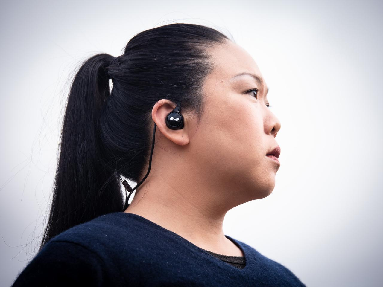 The loop behind your neck can foul collars and hoodies, sometimes feeling like it'll push the earbuds out, but the problem largely goes away when you bend the ear hooks to hold your ears more securely