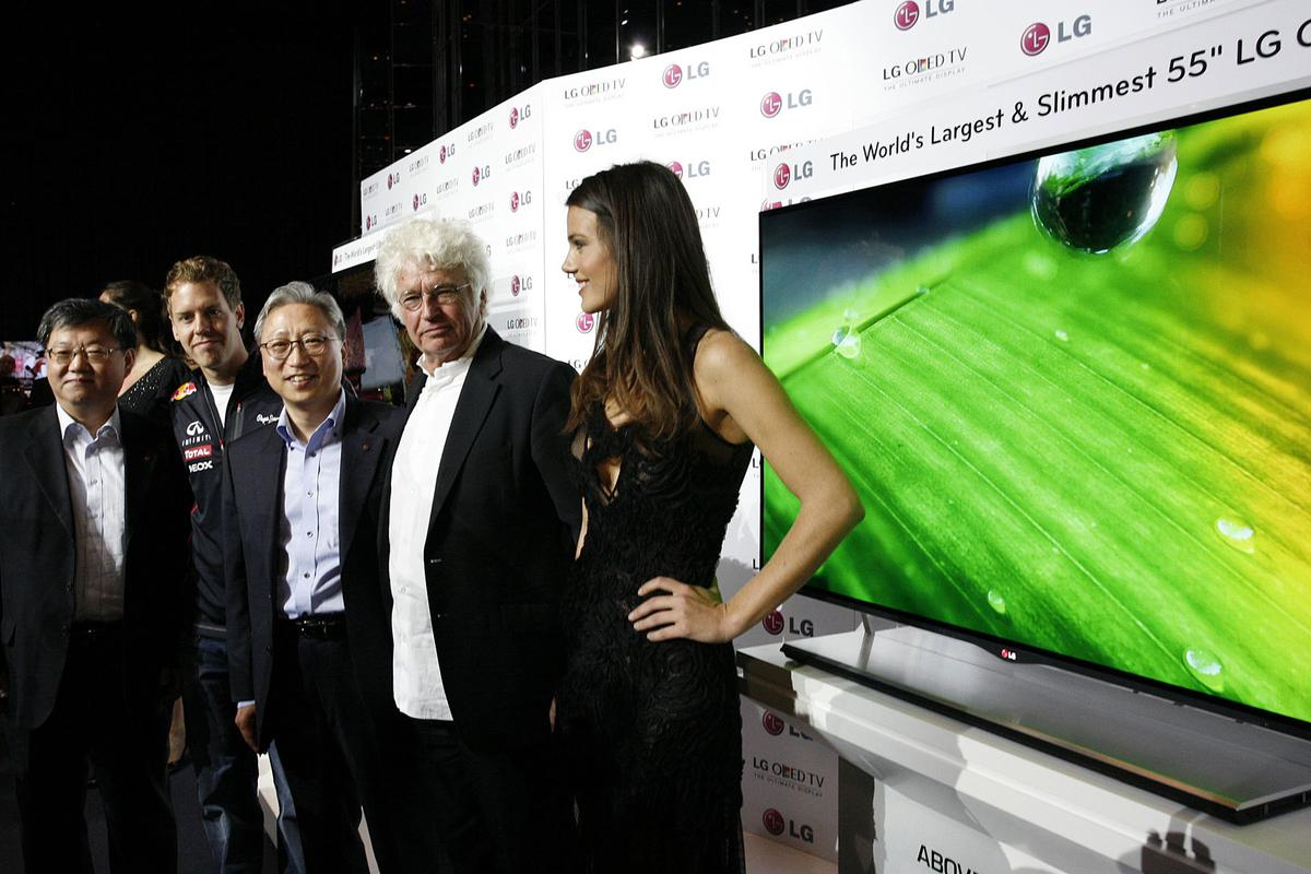 LG VP of Overseas TV Sales and Marketing Ki-il Kwon, F1 Champion Sebastian Vettel, LG Europe's Stanley Cho, film director Jean-Jacques Annaud and model Gemma Sanderson at the Monaco unveiling