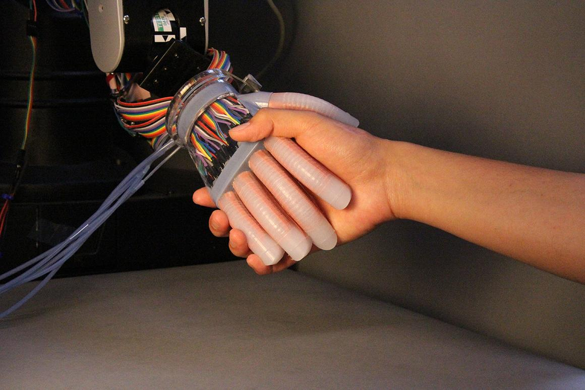 """Researchers have created a prototype prosthetic handthat's able to determine by touch whether fruit is ripe, and the pressure necessary to hold an object firmly, but gently, in response to the way it """"feels"""""""