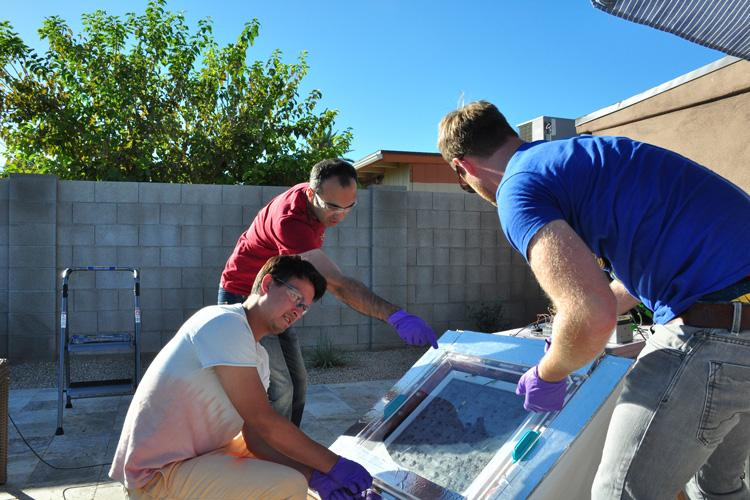 The UC Berkeley researchers test the water-harvesting device prototype in Arizona
