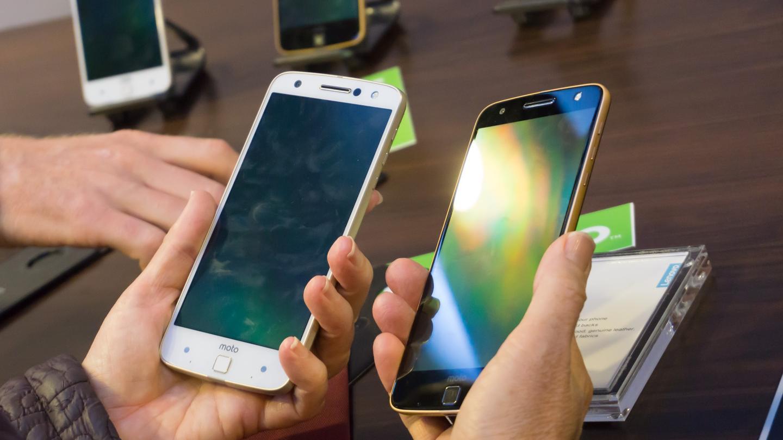 Two Moto Z phones in hand
