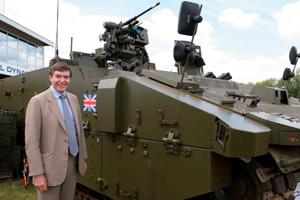 Philip Dunne MP, Minister for Defence Equipment, Support and Technology with SCOUT SV pre-production prototype at DVD 2014 (Image: Crown Copyright)