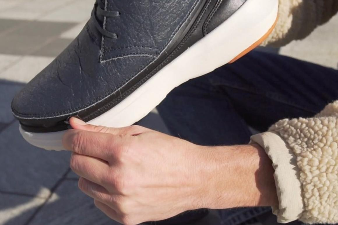 The Chukka-style skin, getting zipped onto one of the soles