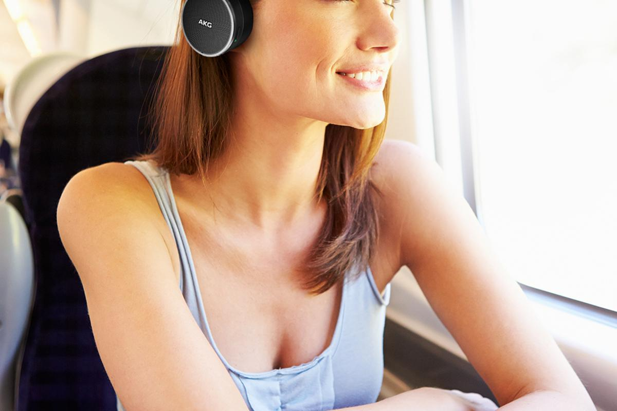 The AKG N60 headphones are designed to lower volume of what is being listened to when the wearer's name is called