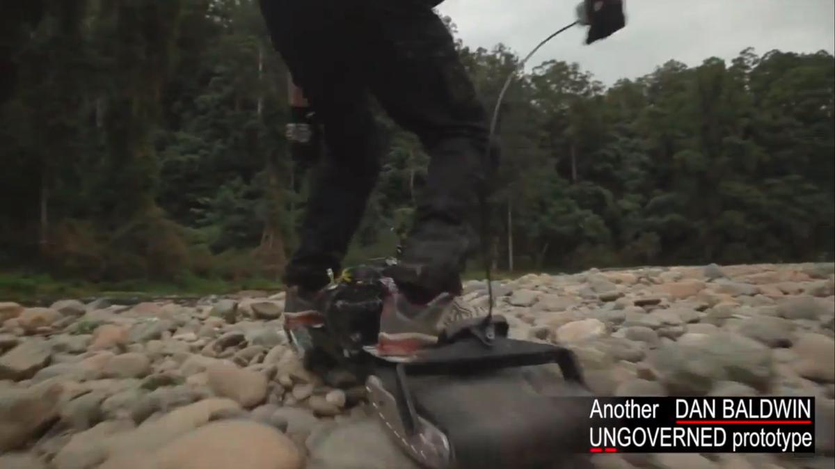 The Ungoverned powerboard motors over some rocks