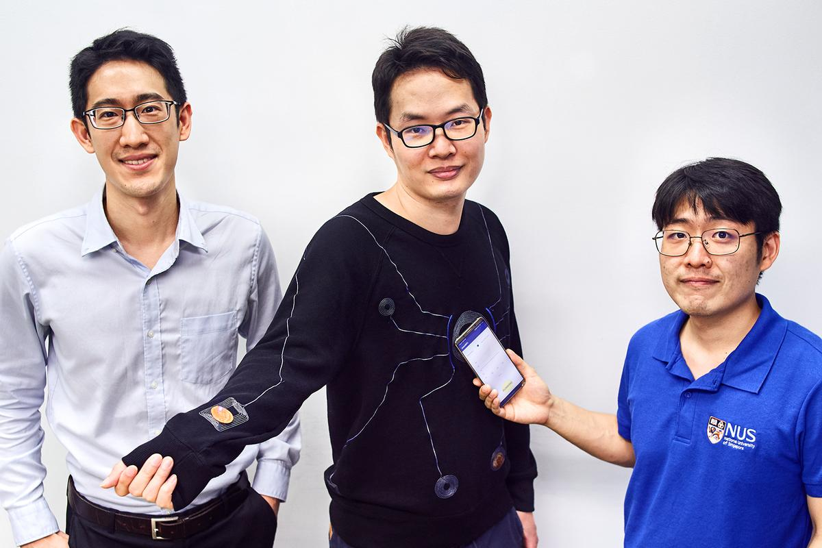 The performance-assessing smart suit, seen here with Asst. Prof. John Ho (left), Dr. Lin Rongzhou (center) and Dr. Kim Han-Joon (right)