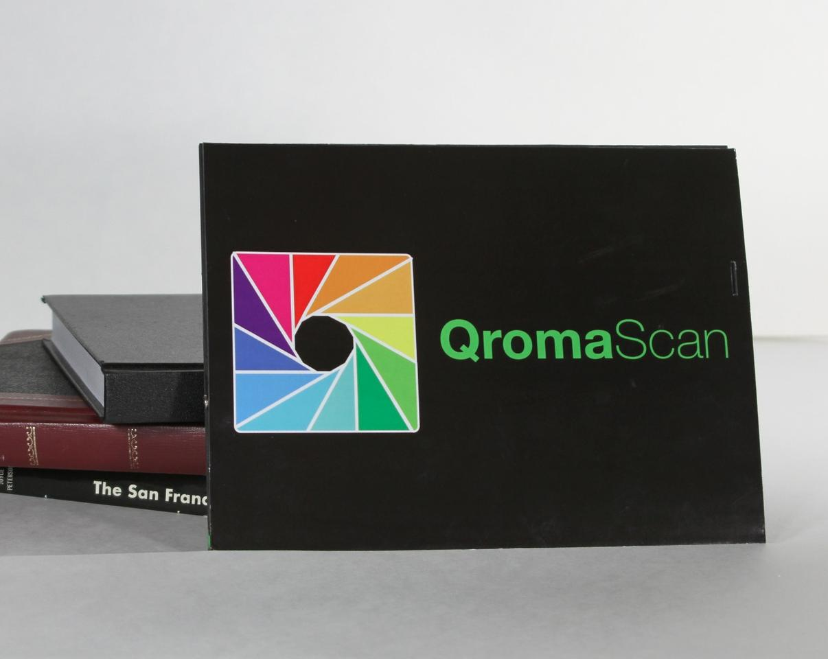 The QromaScan Lightbox folds down to the size of a book when not in use scanning photos
