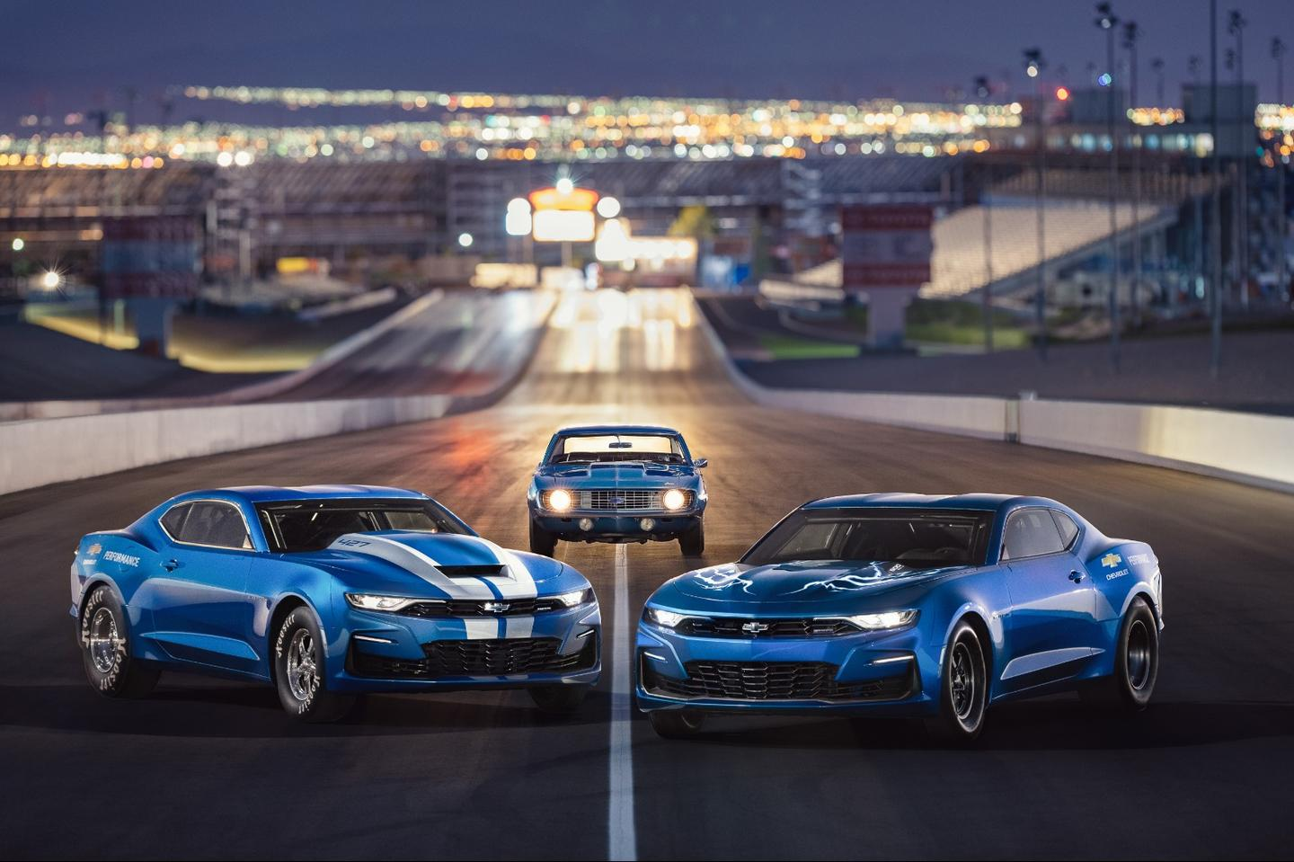 The eCOPO (right) poses with the 2019 COPO Camaro (left) and an original 1969 COPO Camaro (center)