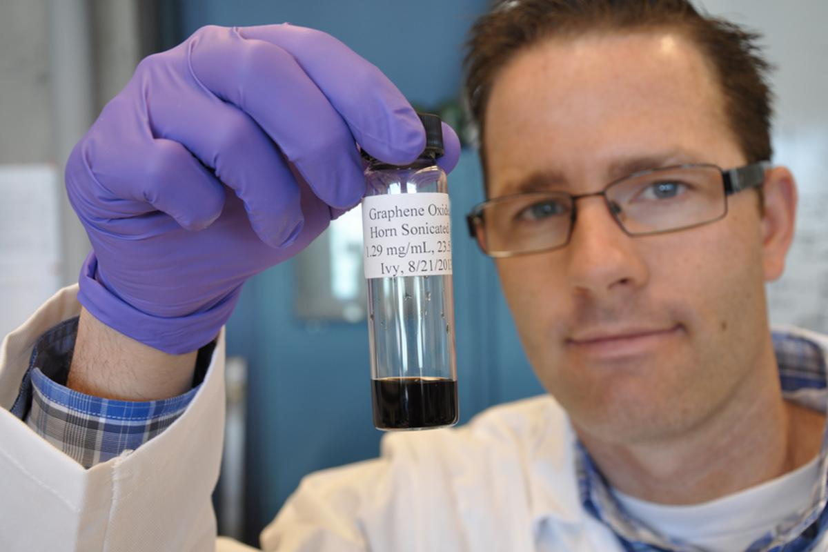 Jacob D Lanphere, a Ph.D. student at UC Riverside, holds a sample of graphene oxide
