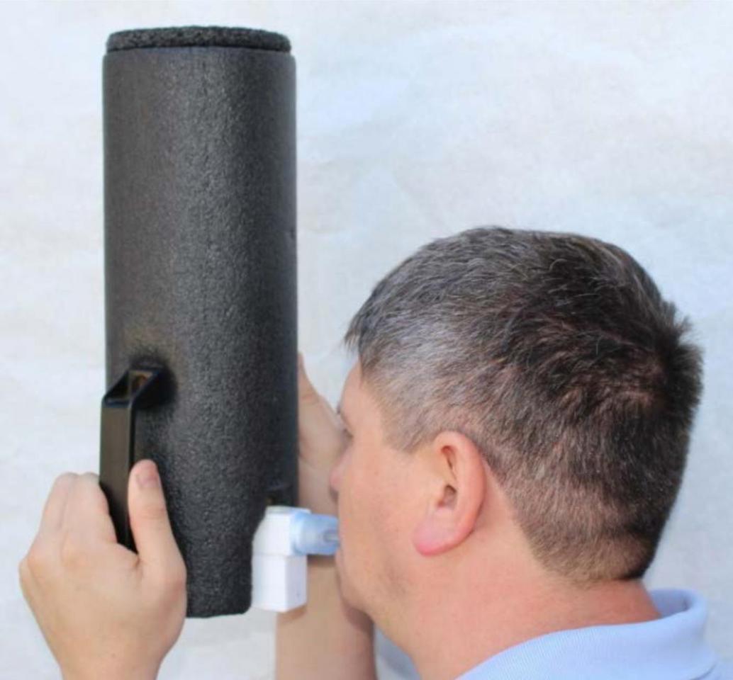 A volunteer breathes into the breath sampler