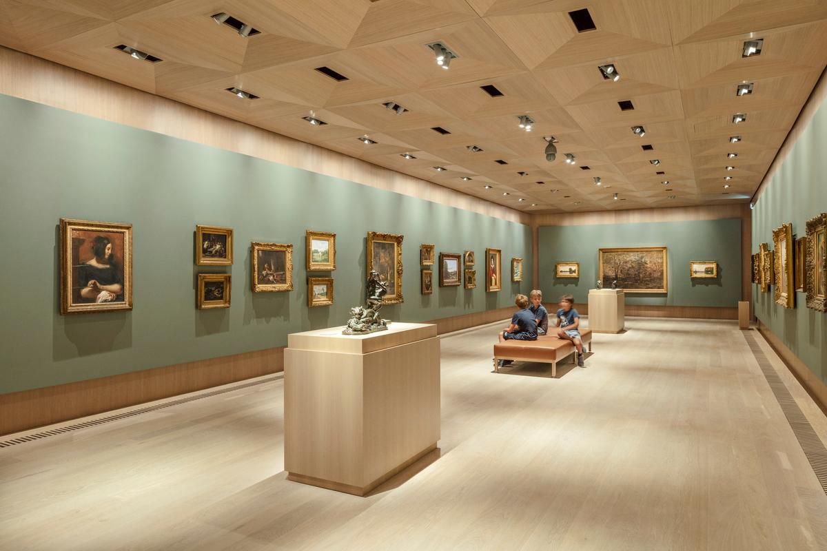 The Ordrupgaard Museum's main gallery areas are furnished with oak floors, walls, and ceilings to create a warm and inviting atmosphere