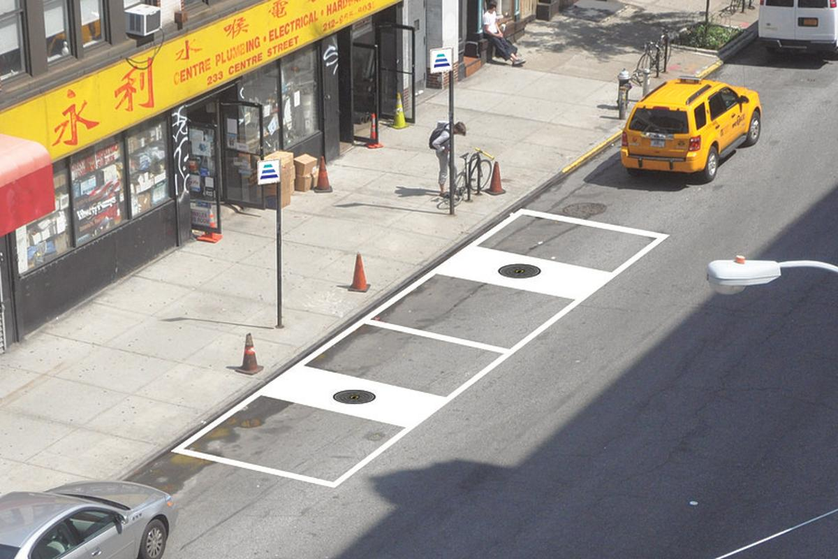 Charging an electric vehicle on the street could be as easy as finding a HEVO charging station, which look like manhole covers