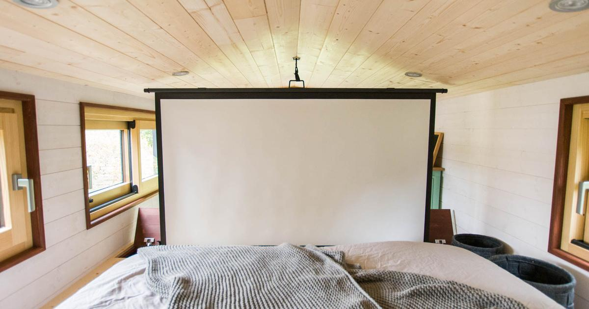 Compact French tiny house turns bedroom into cosy home cinema