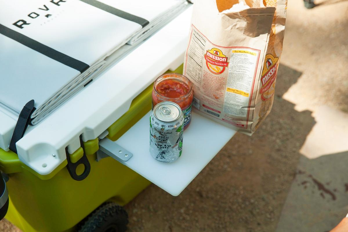 We think a side table would be a better use for the Rovr Rollr cutting board, whilethe collapsible storage bin on top sounded like a good idea, but it always felt like by the time we secured it to the cooler top and filled it with gear, we could have just brought the gear separately