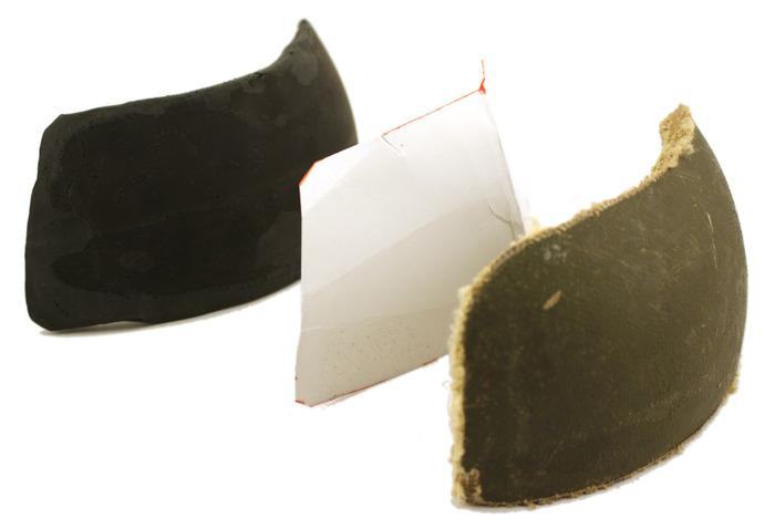 A polymer mock-up of the panel, a paper pattern, and a shooting sample made from a helmet section