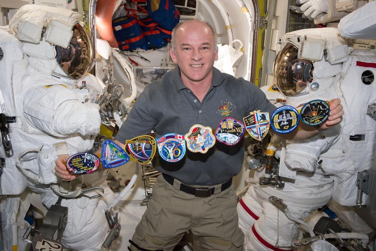 Mission Commander Jeff Williams showing off his mission patches