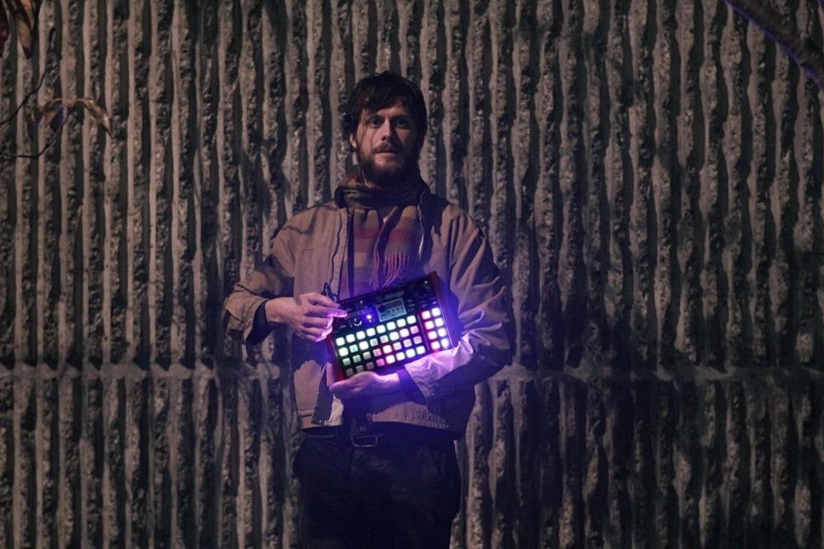 System designer Rohan Hill with the Deluge portable sequencer, synthesizer and sampler