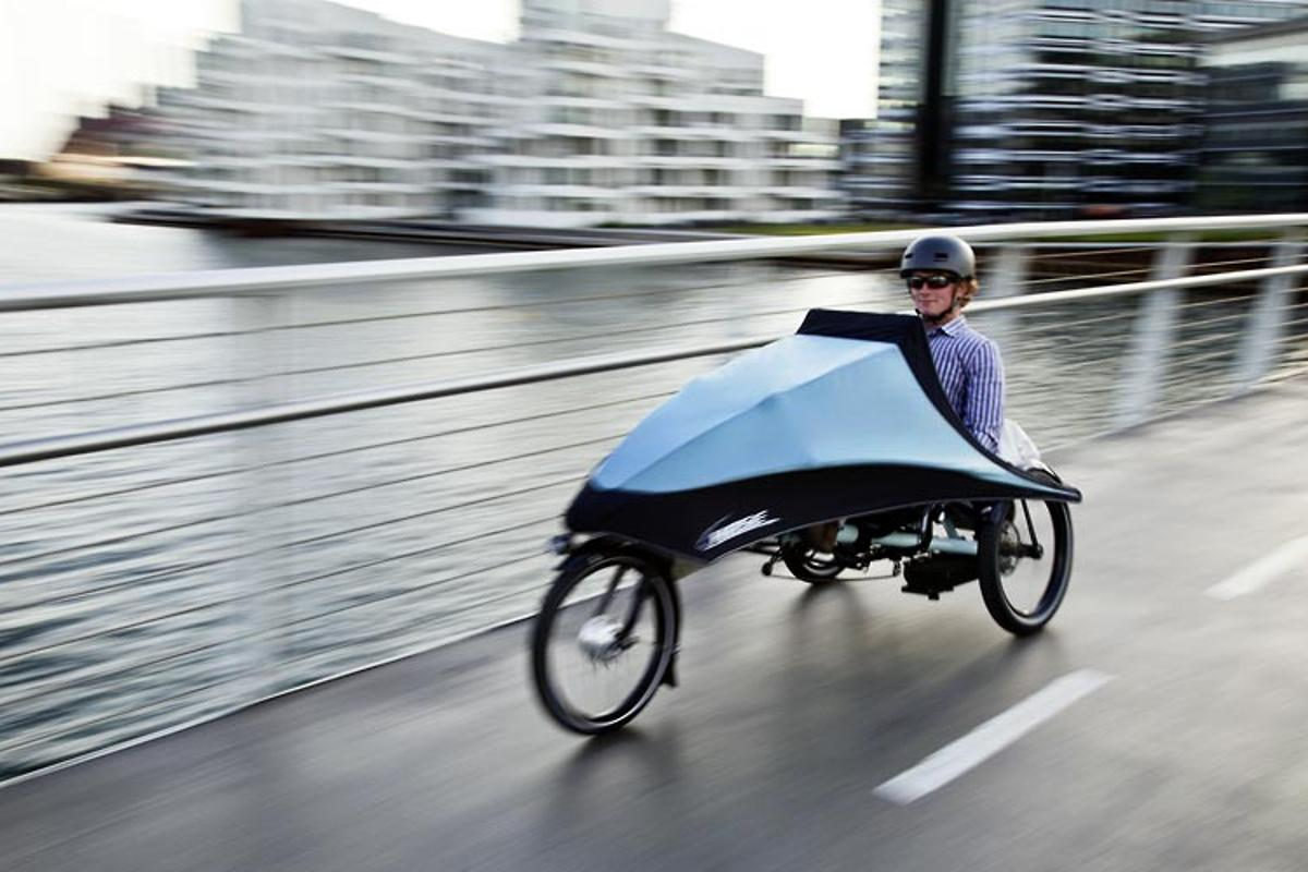 Hase Bikes' KLIMAX tricycle features a detachable folding fairing, allowing users to add weather protection as needed