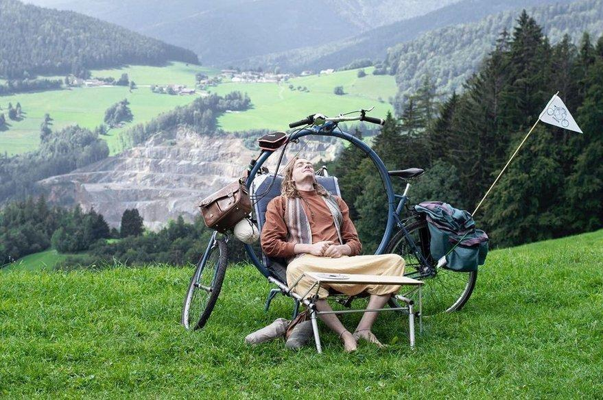 The inventor's friend Liam Cornwell relaxes on the Cercle bike