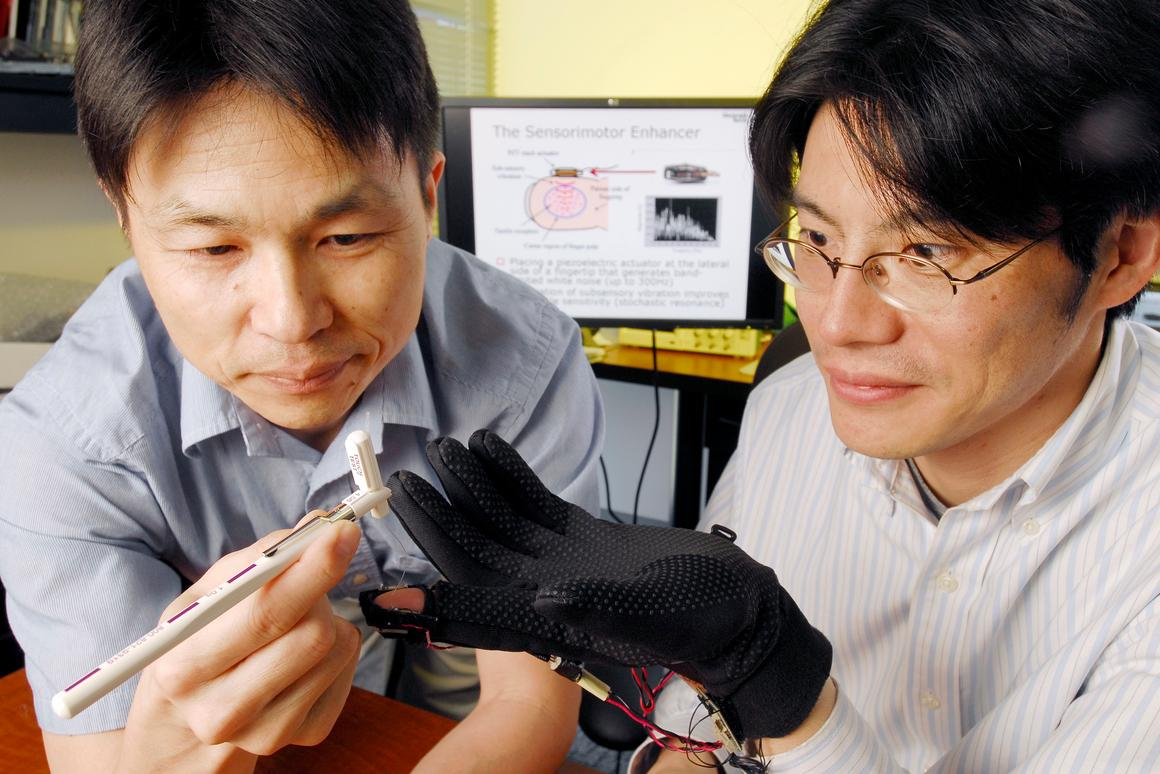 Georgia Tech applied physiology associate professor Minoru Shinohara conducts a single-point touch test on mechanical engineering assistant professor Jun Ueda