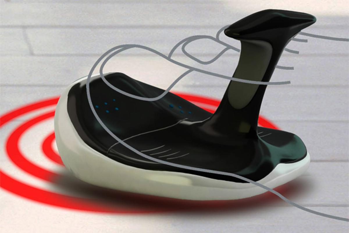 A user grips the fin with the first two toes and moves the mouse around to change the cursor position on screen, sensors at each toe detect click action