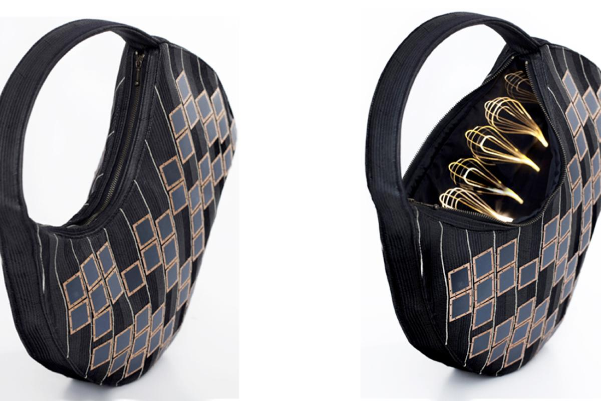 The Solar Handbag has solar cells on the outside and a battery and optical fiber lighting on the inside