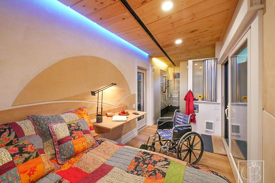 TheWheel Pad'sinterior layout is divided between a main living area with a bed to one side and a bathroom