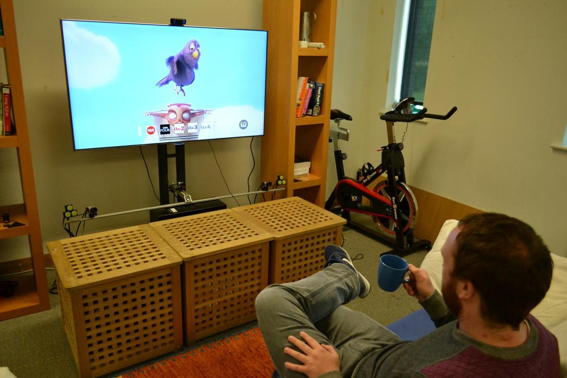 Researcher Christopher Clarke selects a channel to watch by using his mug as a remote control