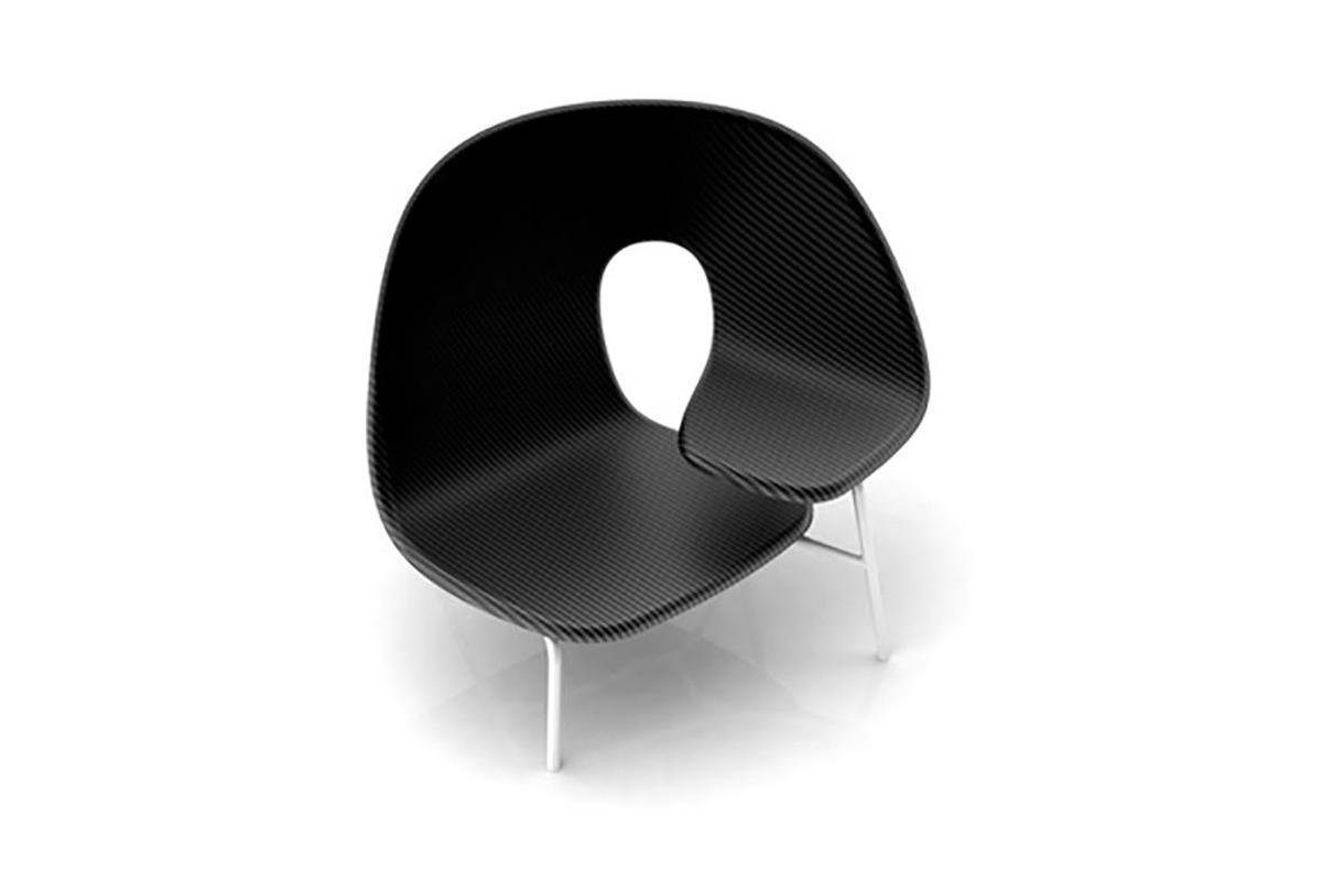 Formed from a single curved sheet of carbon fiber, the hug chair seats two