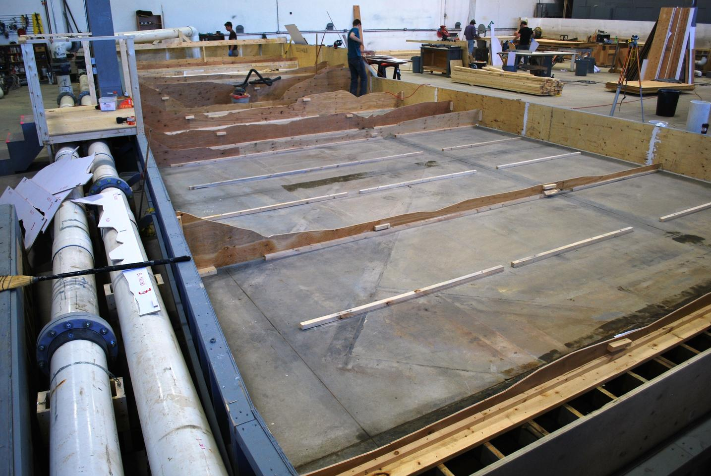 The foundation of the Nybrufossen Whitewater Park model – note the water return pipes at left (Photo: NHC)