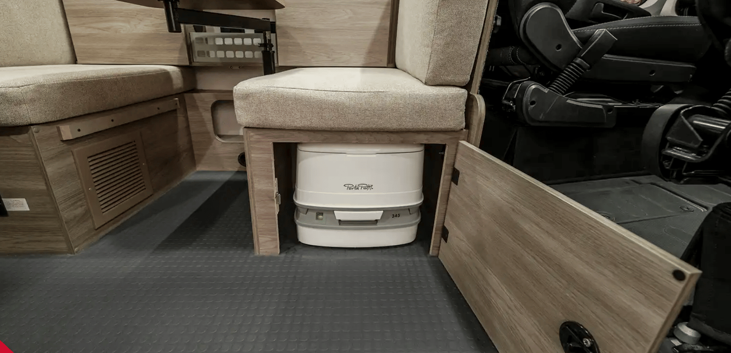 Beyond being a sofa, daybed, spare bed and dining area, the multipurpose lounge has one more trick: a hidden portable toilet