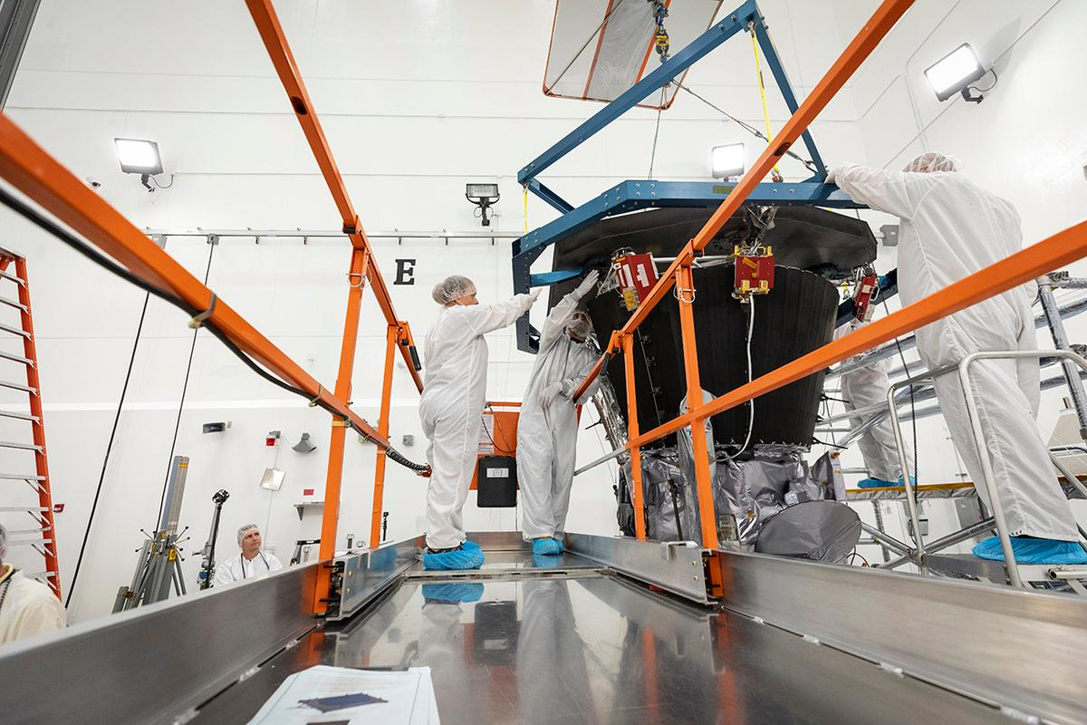 NASA engineers attach the heat shield to the Solar Parker Probe