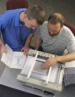 Researchers John Roberts (right) and Oliver Slattery (left) using the tactile graphic display device.