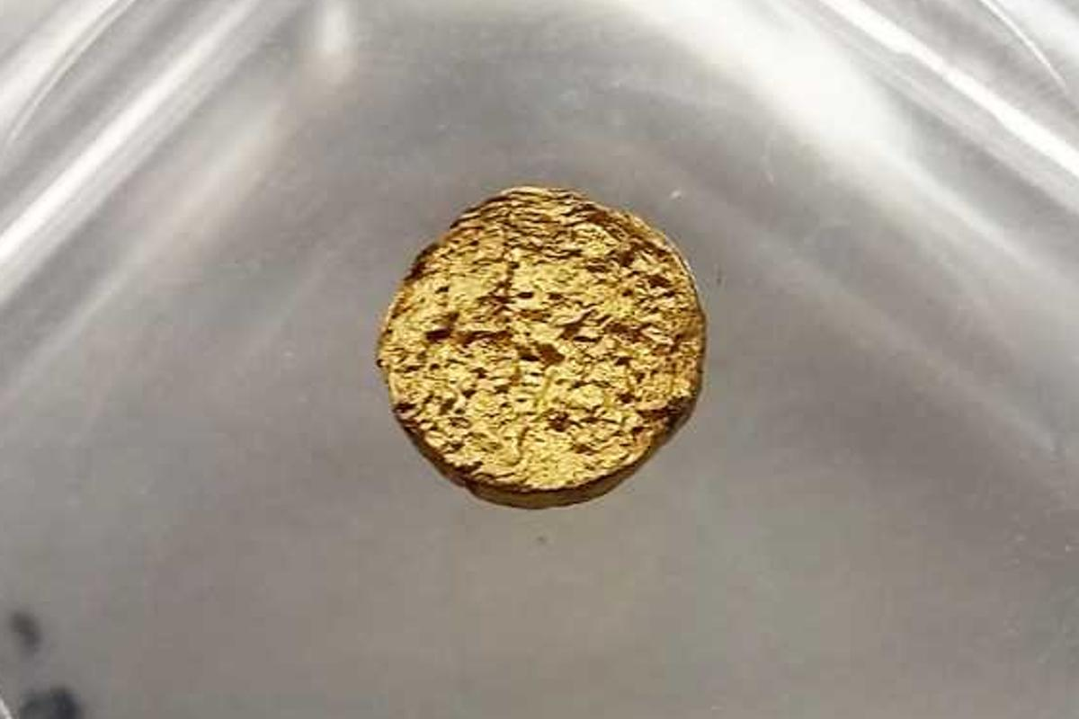 A piece of the new lightweight gold made with plastic