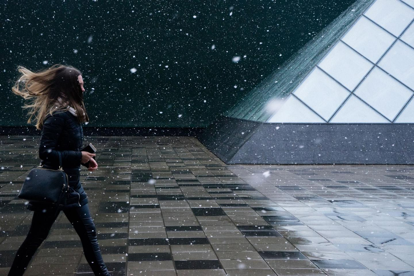 Winner of the Travel category. Spring Snow  is a capture of a woman walking in a magical light snowfall, backgrounded by beautiful geometries