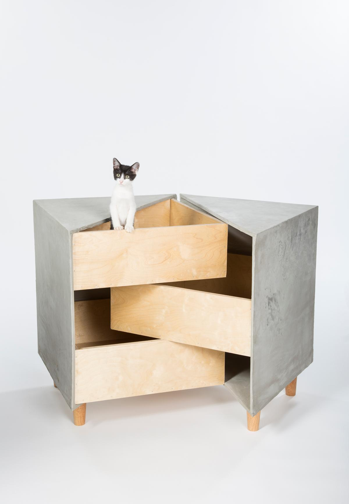 Sneaky Drawers, by rdc, is a shelter based on three intersecting drawers that provides a sanctuary for multiple cats