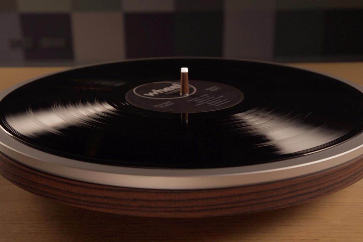 The underside of the record is played using a tonearm and cartridge mounted within the body of the Wheel turntable