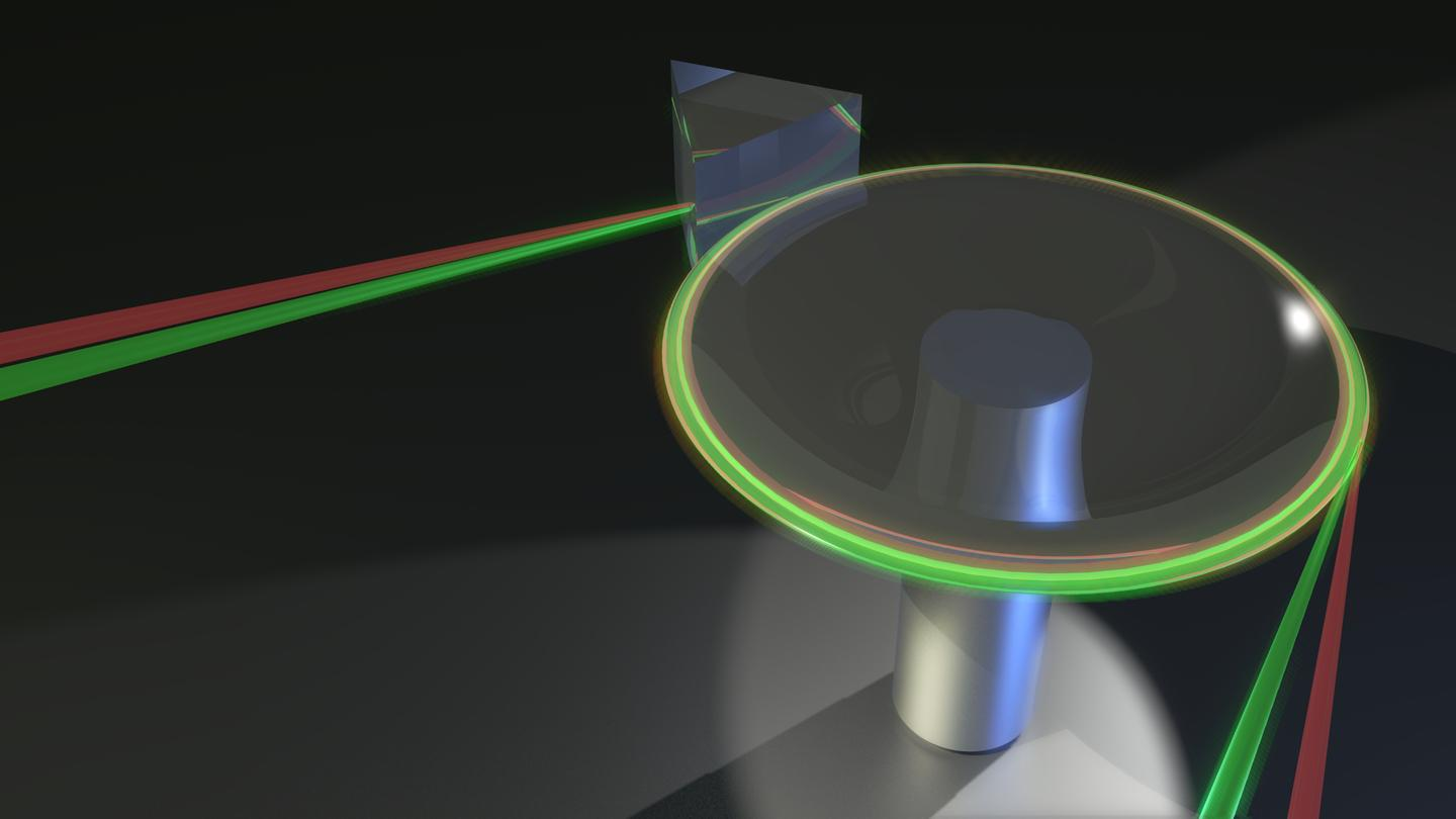 The thermometer works by exploiting the difference between the speed of two different beams of colored light when traveling through a heated crystalline disk (Image: Dr. James Anstie, University of Adelaide)