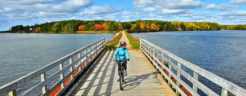 Bicyclist crossing a bridge on The Great Trail in Canada