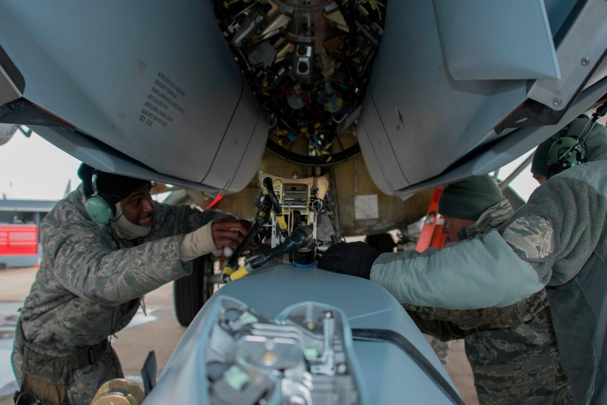Aircraft armament systems specialists assigned to the 307th Aircraft Maintenance Squadron unload a AGM-158 Joint Air-to-Surface Standoff Missile from a Conventional Rotary Launcher