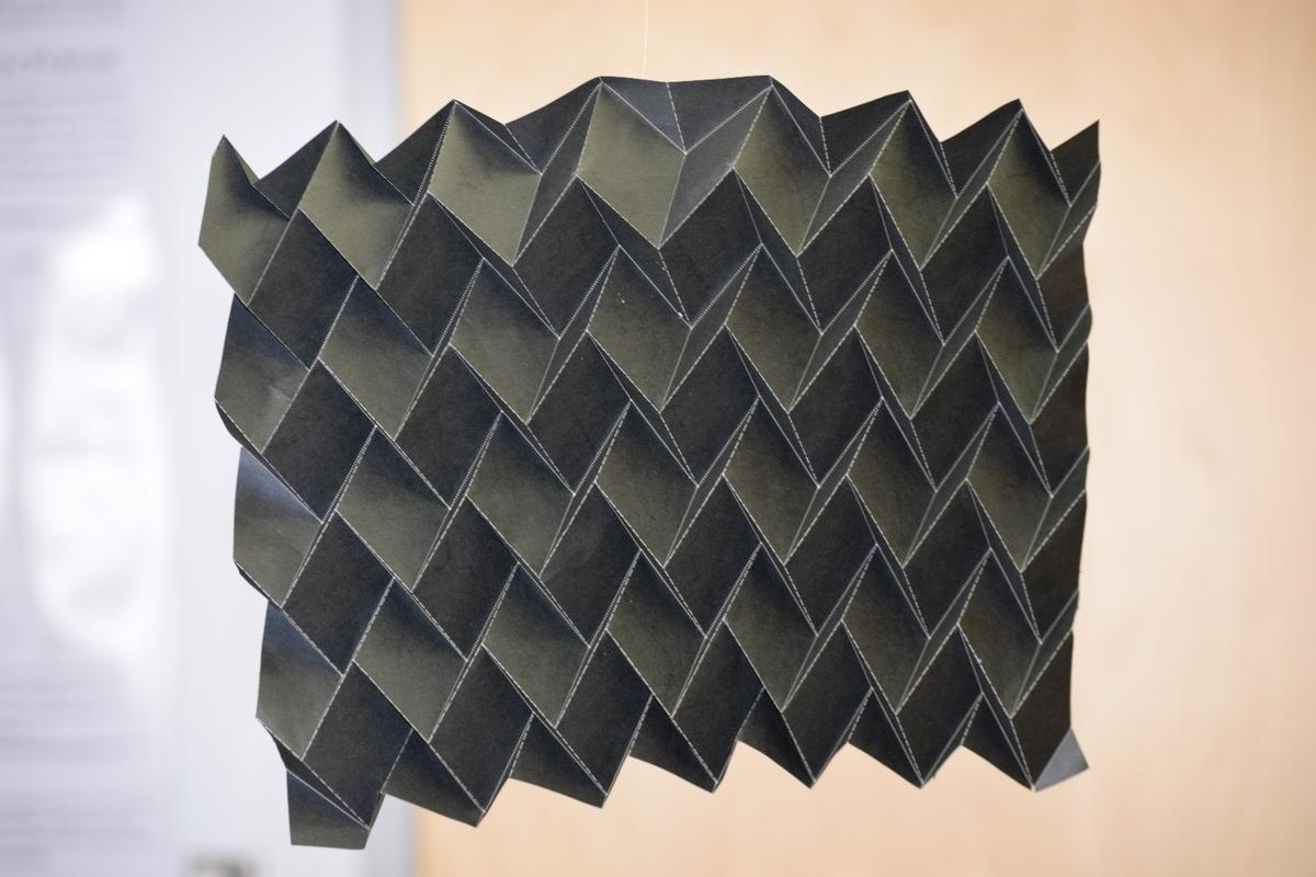 The folding radiator could replace existing flat, heavy satellite radiators