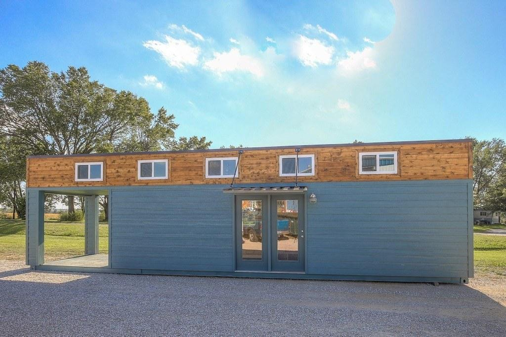 The unnamed container home is clad in smart lap siding with cedar edging