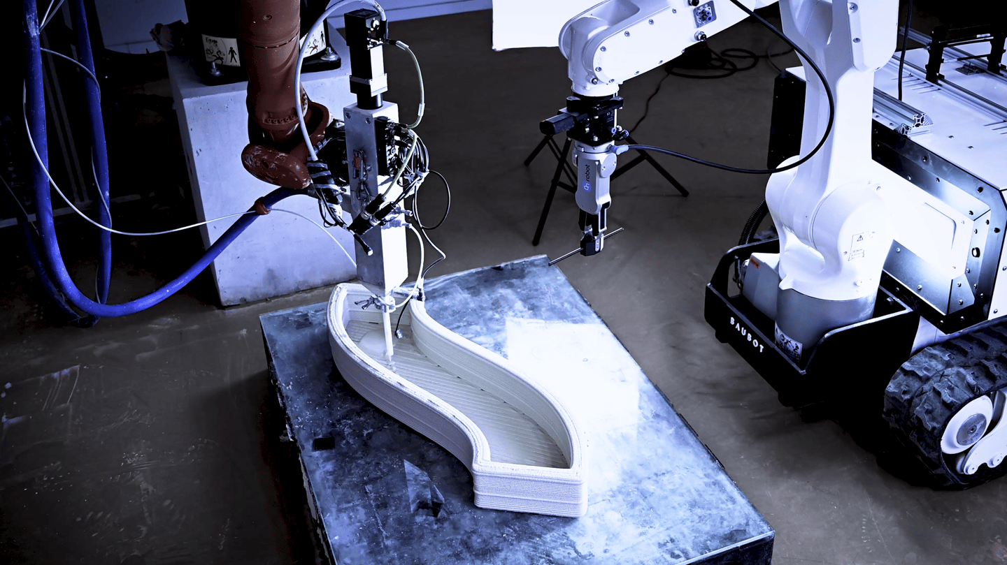 The Baubot helps a 3D-printing robot at the construction site