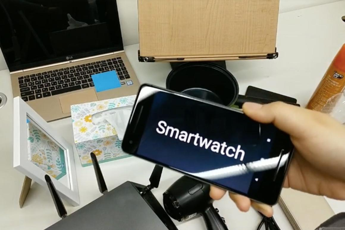 A Knocker-equipped smartphone, after being knocked against a smartwatch