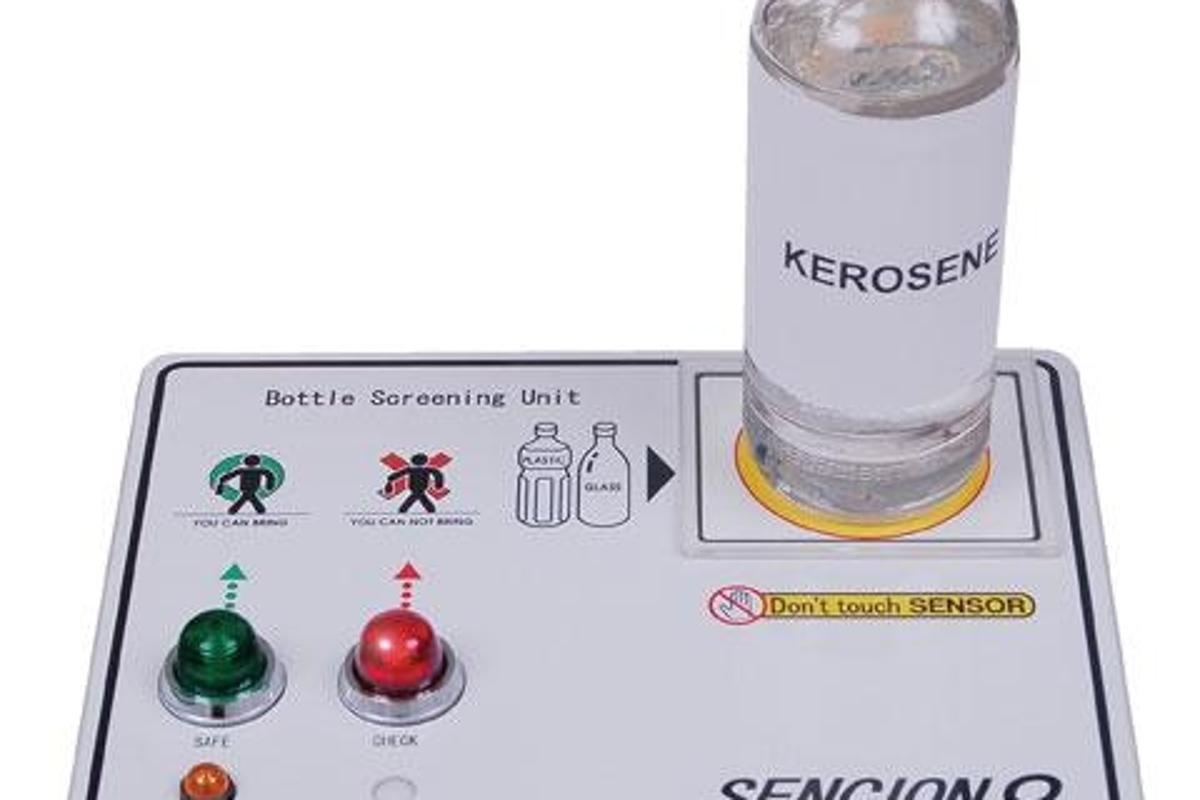 Sellex's Sencion thread liquids detector - the flashing red light indicates the presence of a threat liquid like Kerosene.