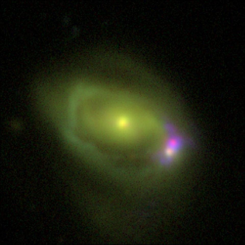 When galaxies collide: Was 49a is seen in green and Was 49b is in pink