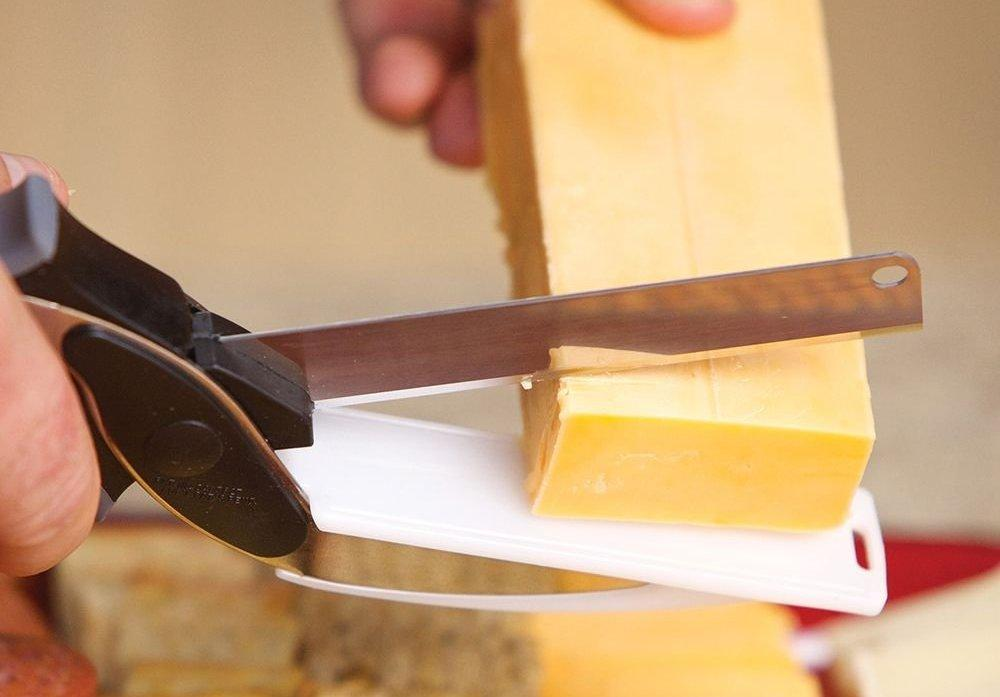 The Clever Cutter is a pair of scissors for meat, cheese and veggies, with a built-in mini chopping board