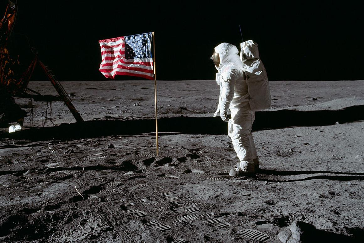 Buzz Aldrin planting a US flag on the Moon –for purely symbolic purposes of course