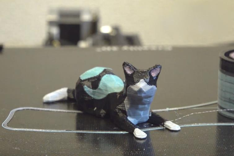 A 3D-printed cat, made from one filament comprised of four types of PLA (polylactic acid) plastic